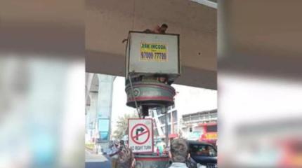 حیدرآباد:ذہنی متاثرشخص نے ٹریفک پوسٹ پرچڑھ کر خودکشی کی کوشش کی